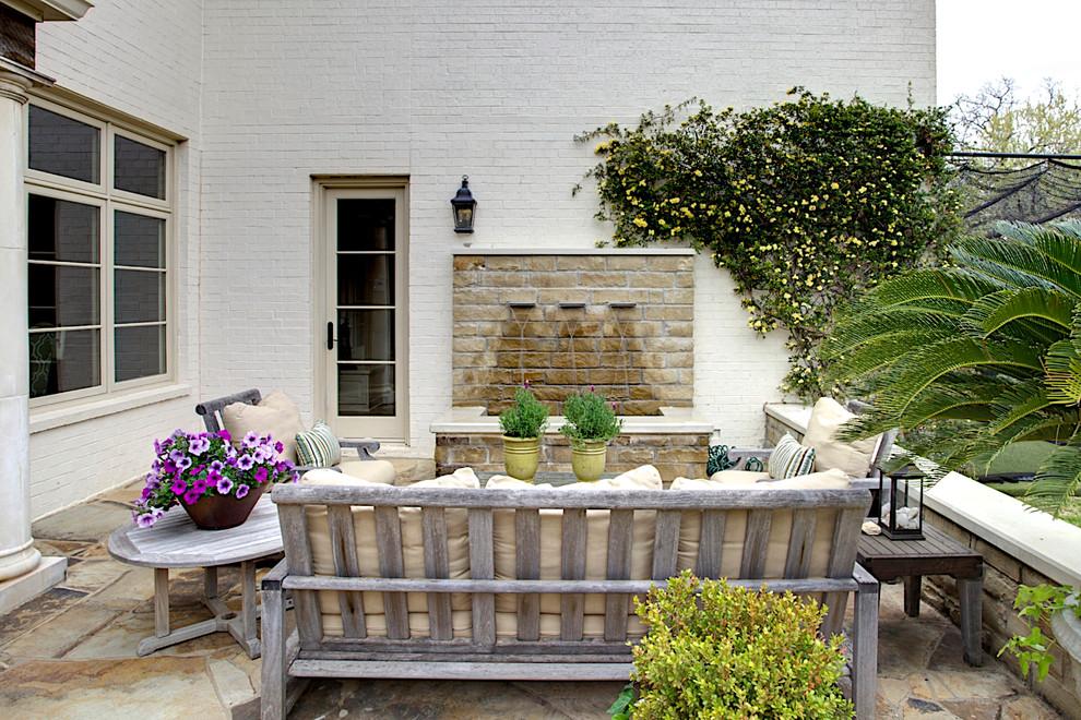 Example of a tuscan patio fountain design in Dallas