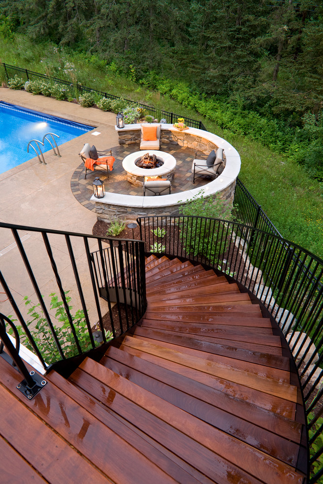 Elegant patio photo in Minneapolis with a fire pit and decking