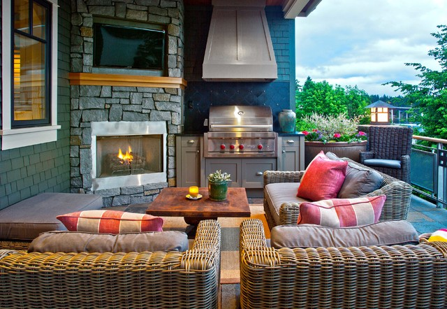 Example of a mid-sized classic backyard stone patio design in Seattle with a fire pit and a roof extension