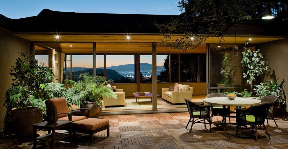 Patio - large contemporary courtyard patio idea in San Francisco with decking and no cover