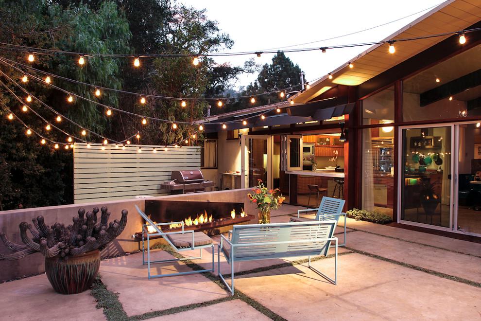 Example of a 1960s backyard patio design in Santa Barbara