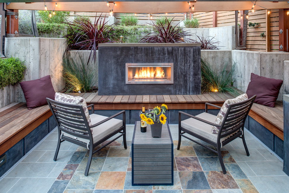 Example of a mid-sized trendy tile patio design in San Francisco with no cover and a fireplace