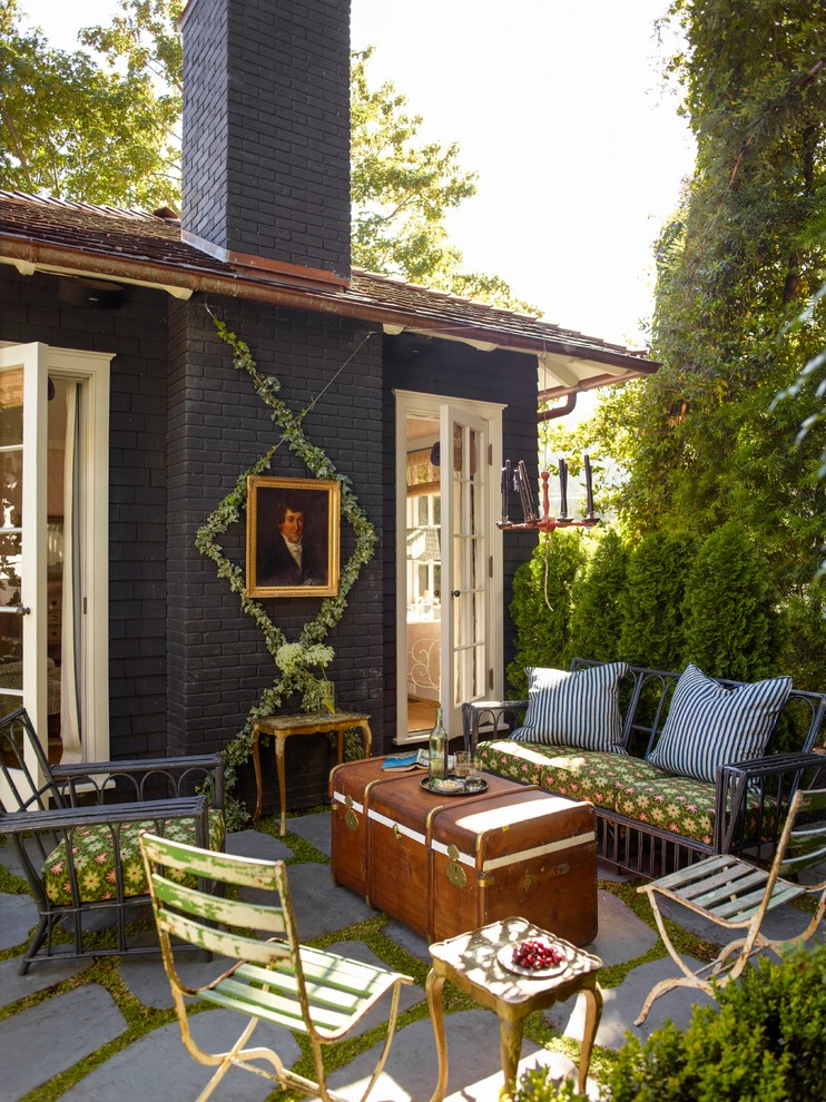 Inspiration for a small victorian concrete paver patio remodel in San Francisco with no cover