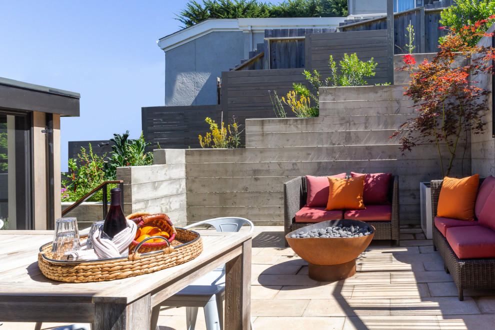 Inspiration for a mid-sized contemporary backyard patio remodel in San Francisco with a fire pit and no cover