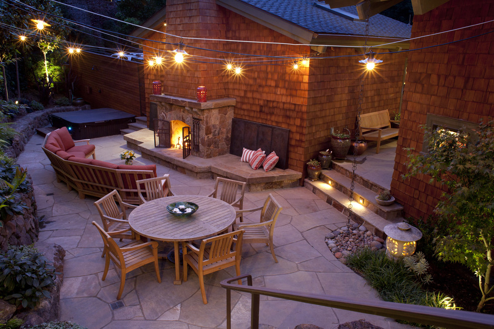 Patio - traditional stone patio idea in San Francisco with a fire pit