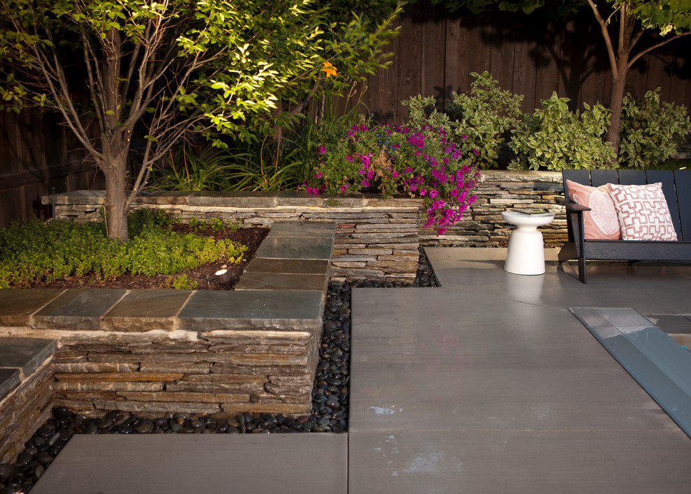 Inspiration for a contemporary backyard patio remodel in Salt Lake City