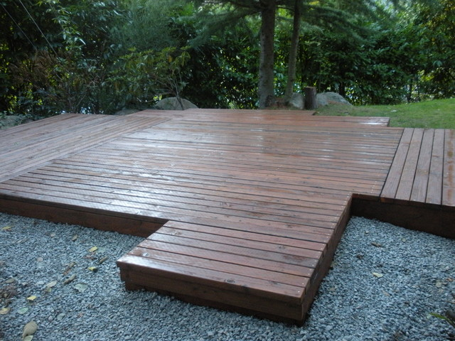how to build a floating deck on a slope