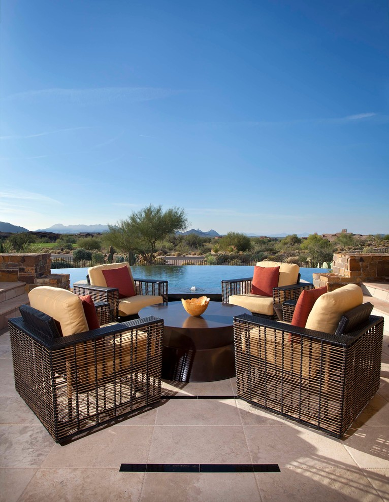 Large tuscan backyard stone patio photo in Phoenix with no cover