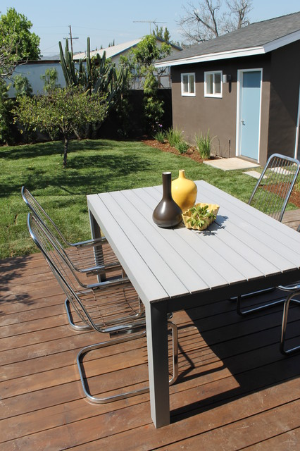 Modern Chrome Cantilever Deck Chairs with IKEA Table modern-patio
