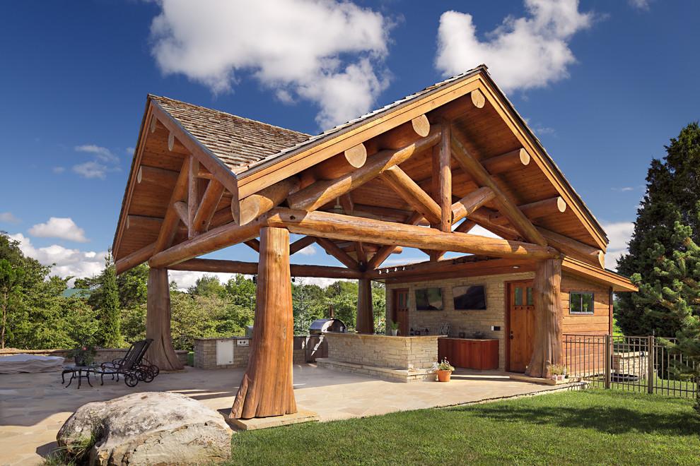 Mountain style backyard patio kitchen photo in Boise