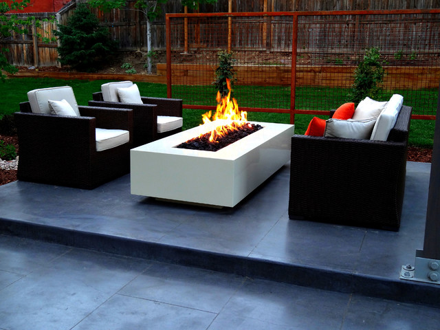 modern fire pit on smooth finish concrete patio