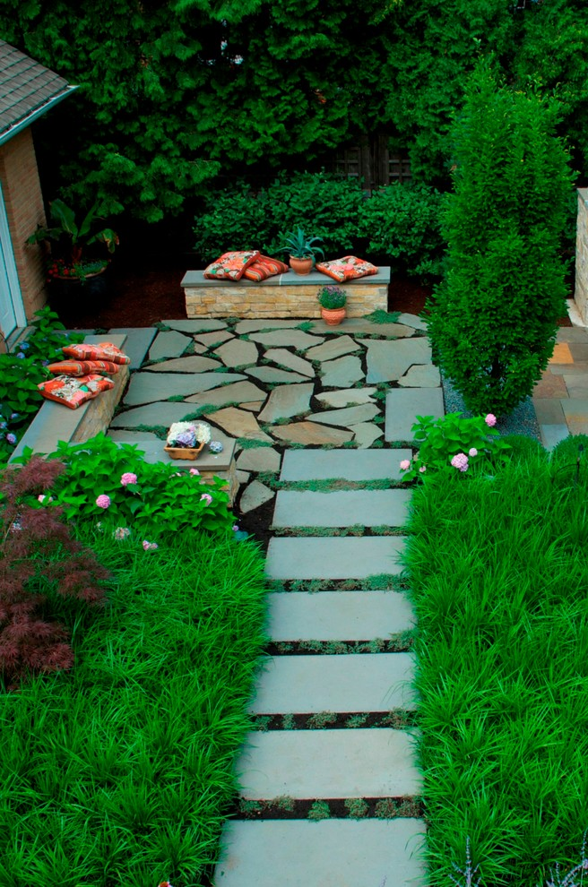 Example of a trendy stone patio design in Chicago
