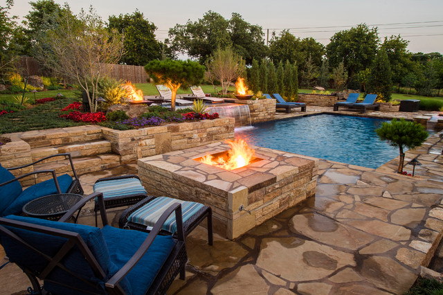 Modern geometric pool with fire features and sun shelf for Pool design tv show