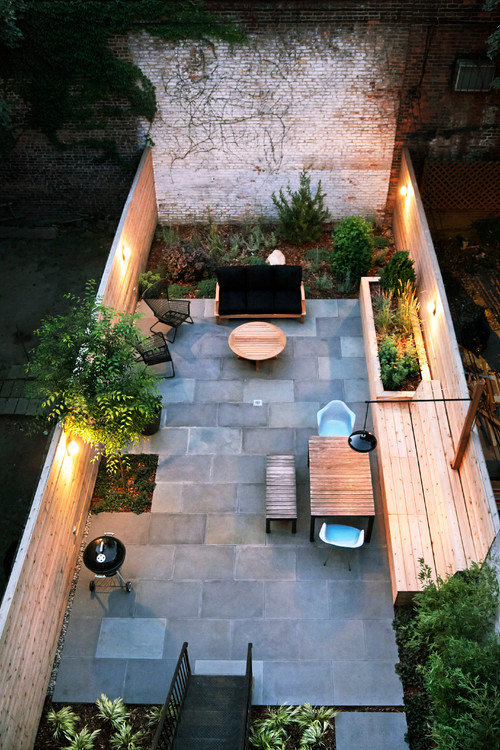 Wall lighting is a great way to get lighting into your backyard without much installation. In a space like this it is likely the best idea to integrate the lighting into the walls. The space is small enough that the wall lighting does a good job of illuminating the space.