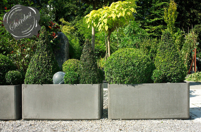 Modern landscape and patio design with large modern garden planters