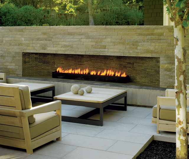 Landscape architect Andrea Cochran added warmth to this outdoor living space with a long modern fireplace. Photo by Marion Brenner for California Home + Design