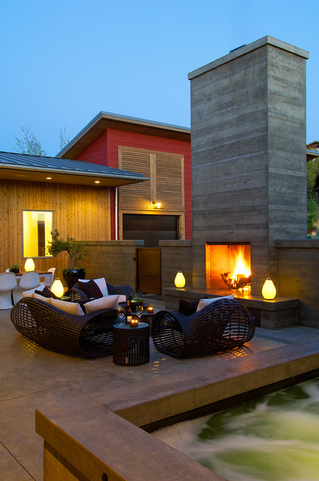 Example of a trendy patio design in Other with a fire pit
