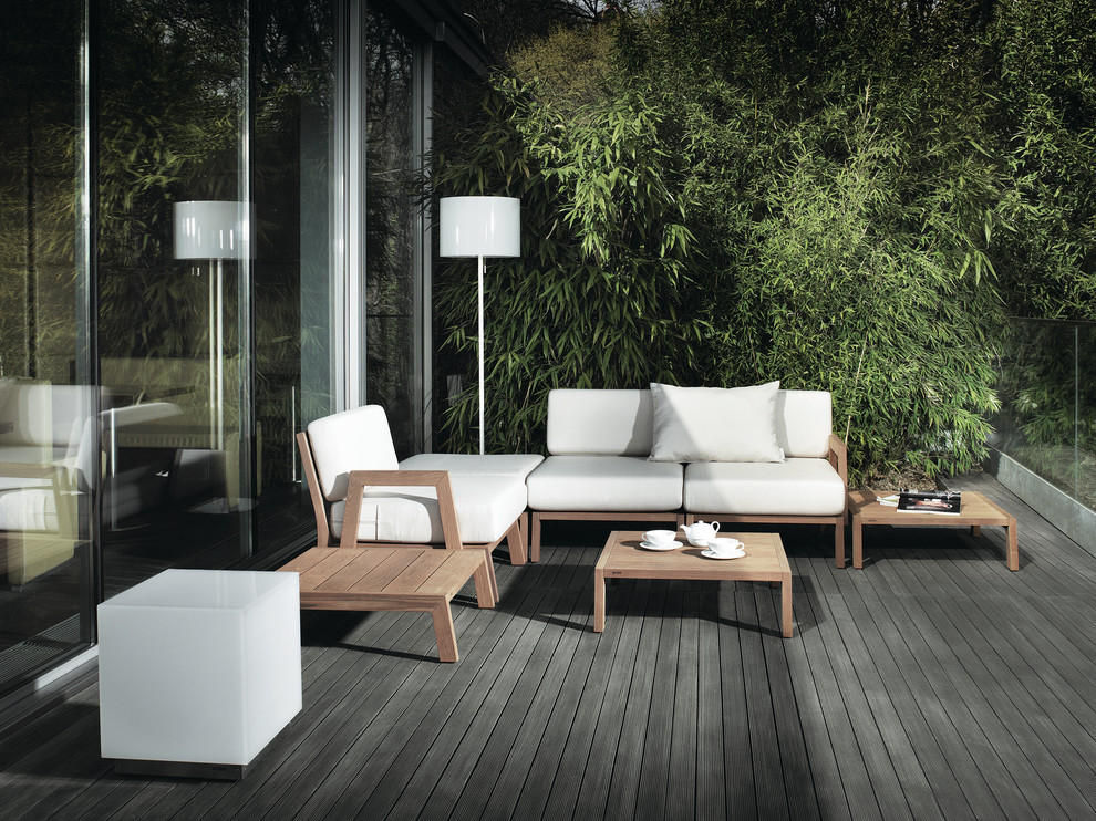 Example of a minimalist patio design in Other with decking