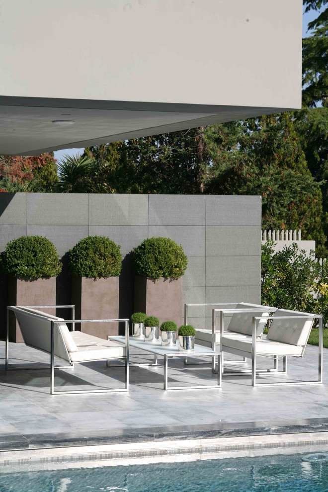 Patio - modern patio idea in Other