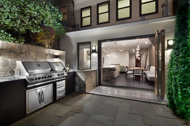 Inspiration for a contemporary backyard stone patio kitchen remodel in DC Metro with no cover