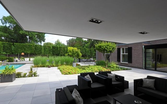 Moderne veranda bij klassiek huis modern patio amsterdam by stoop tuinen - Veranda modern huis ...