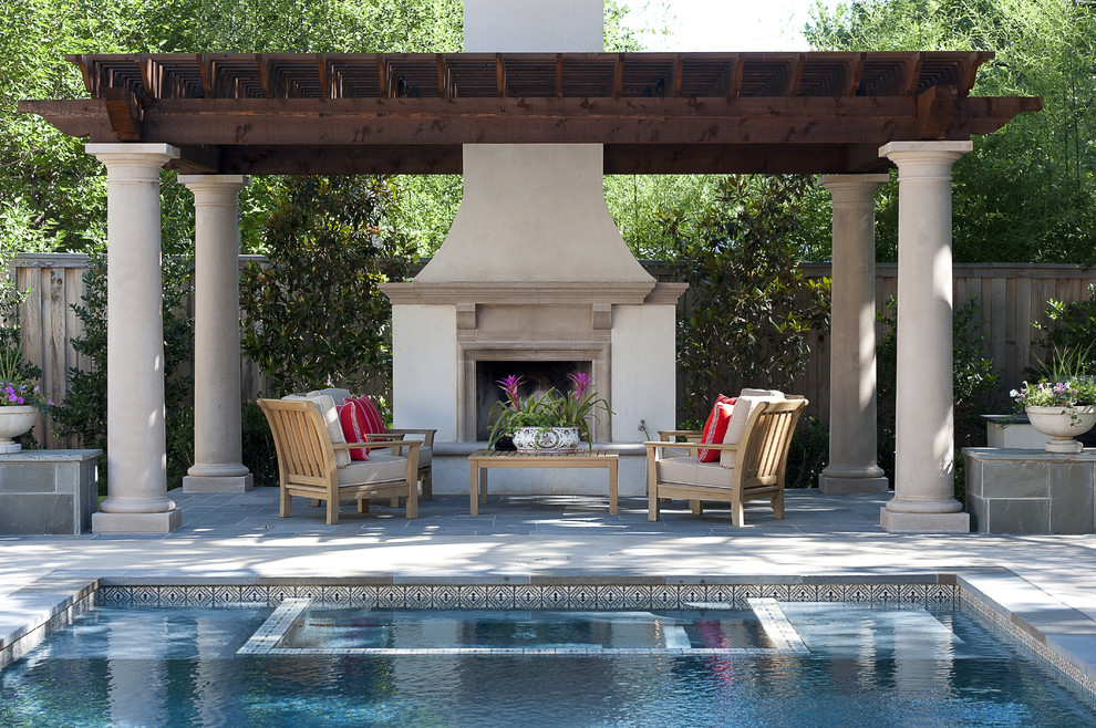 Example of a mid-sized classic backyard brick patio design in Dallas with a fire pit and a gazebo