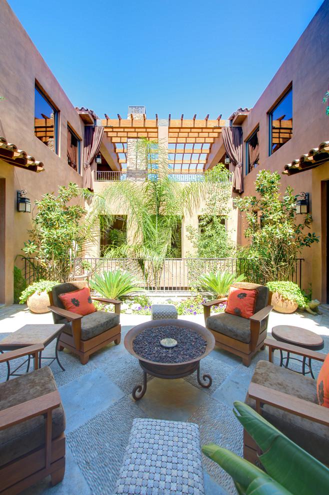 Patio - mediterranean courtyard patio idea in Las Vegas