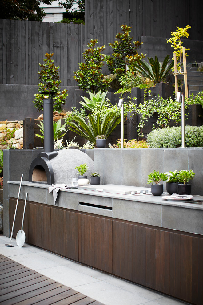 Inspiration for a huge contemporary backyard patio kitchen remodel in Sydney with no cover