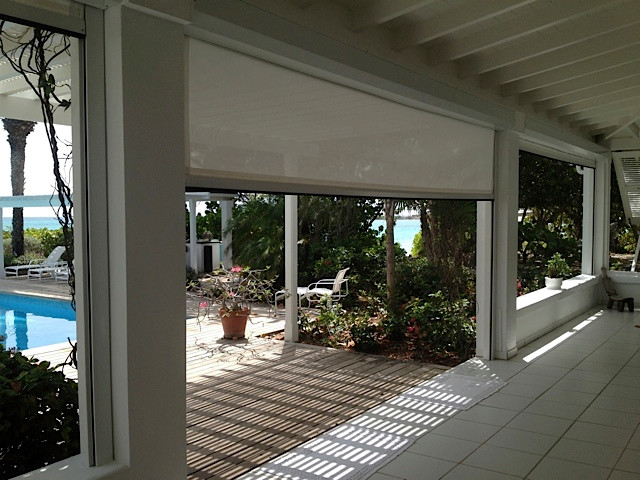 Motorized retractable hurricane patio screen beach style for Retractable patio screens