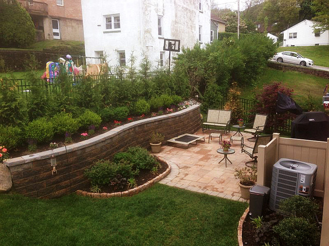 multi level yard patio below retaining wall