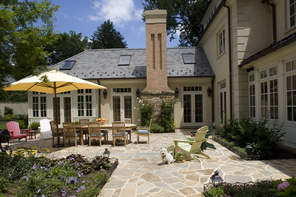 Elegant stone patio photo in Baltimore with no cover