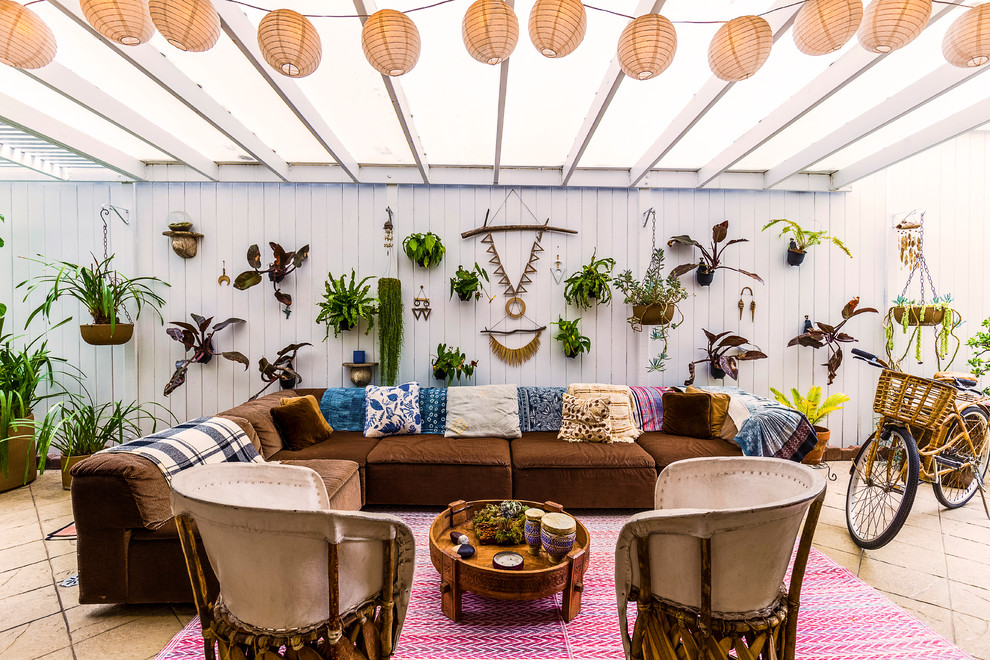 Beach style courtyard patio photo in Los Angeles with a pergola