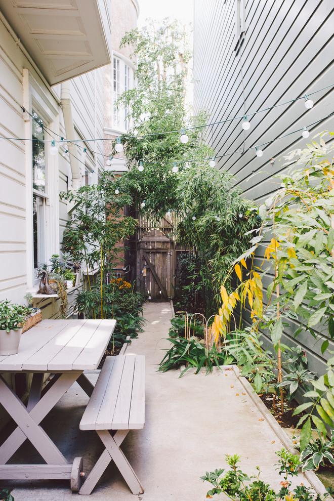 Small elegant concrete patio photo in San Francisco with no cover