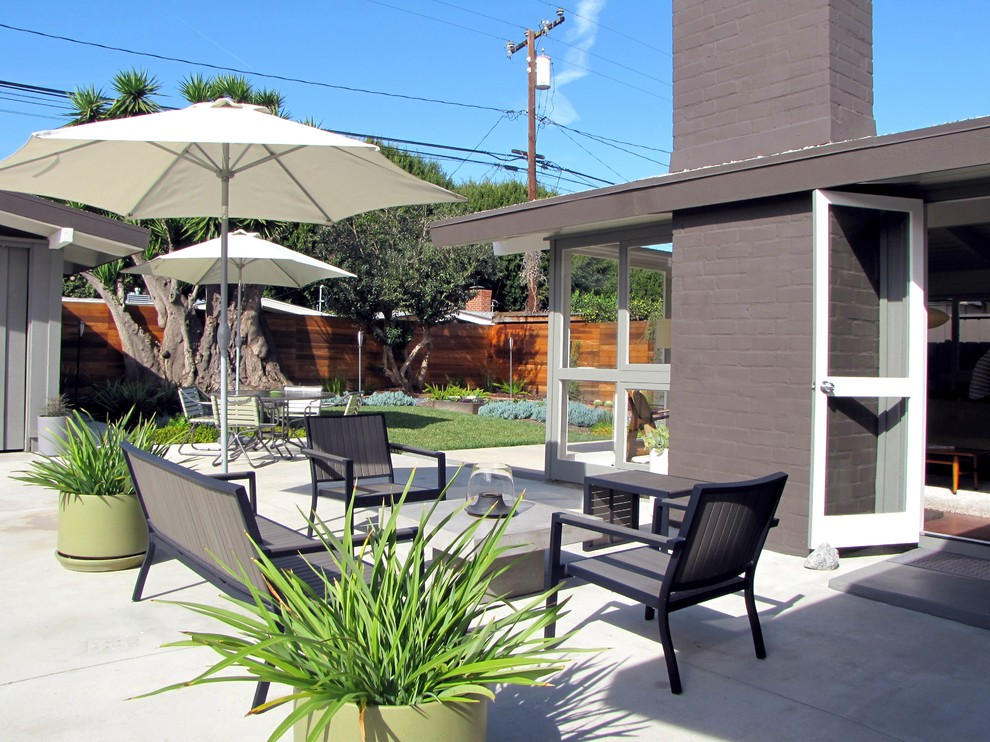 Inspiration for a 1960s patio remodel in Orange County with no cover