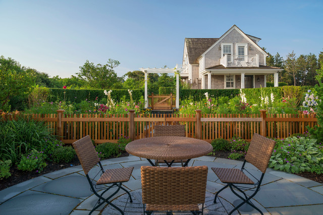 Inspiration for a large beach style backyard stone patio vegetable garden remodel in Boston with no cover