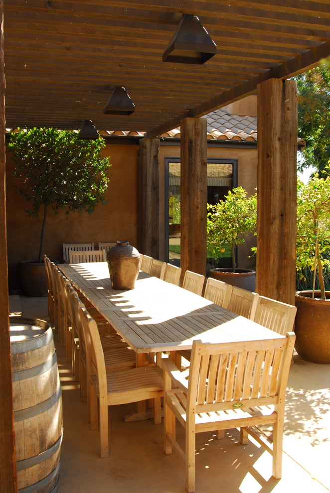 Patio - mediterranean patio idea in Other with a roof extension