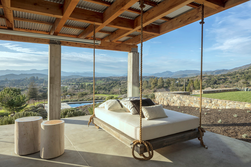 Patio - mediterranean patio idea in San Francisco with a roof extension