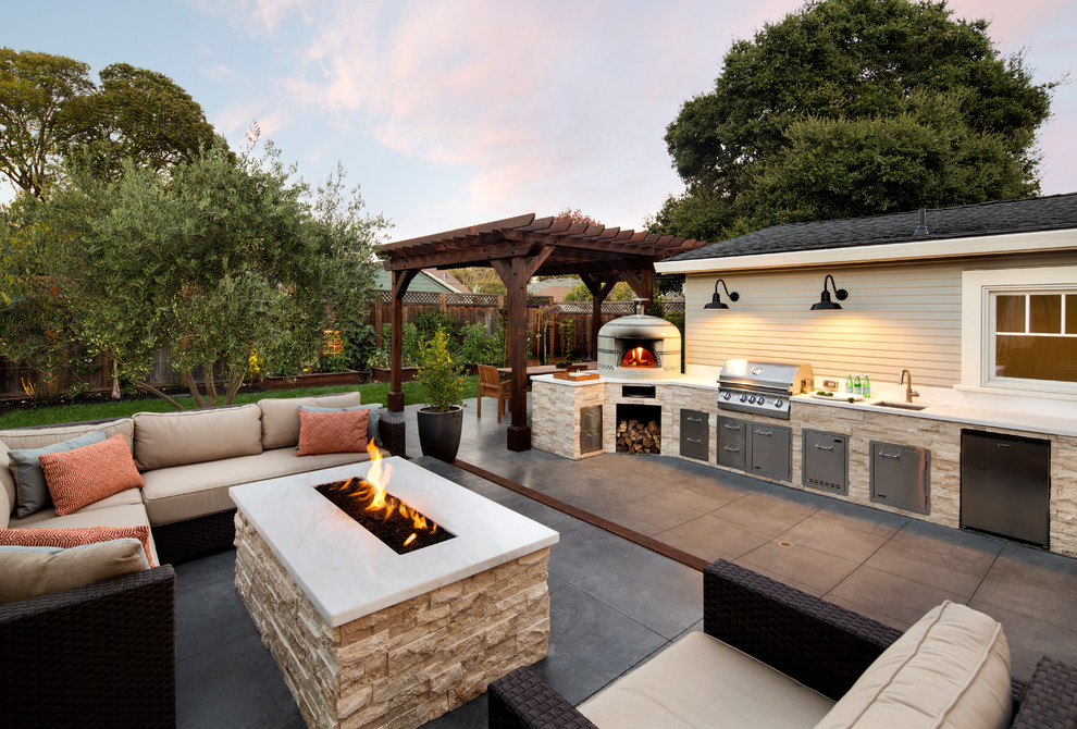 Example of a mid-sized classic side yard patio kitchen design in San Francisco with a pergola