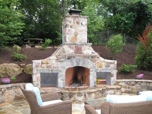 Natural Stone Fireplace With Firewood Storage