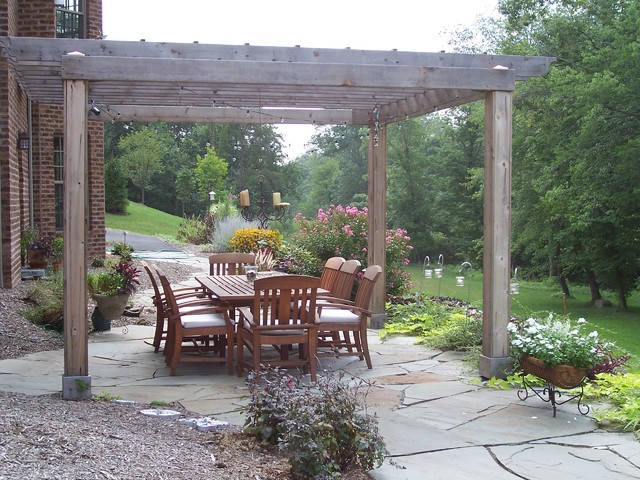 Natural stone patio with cedar pergola traditional patio other