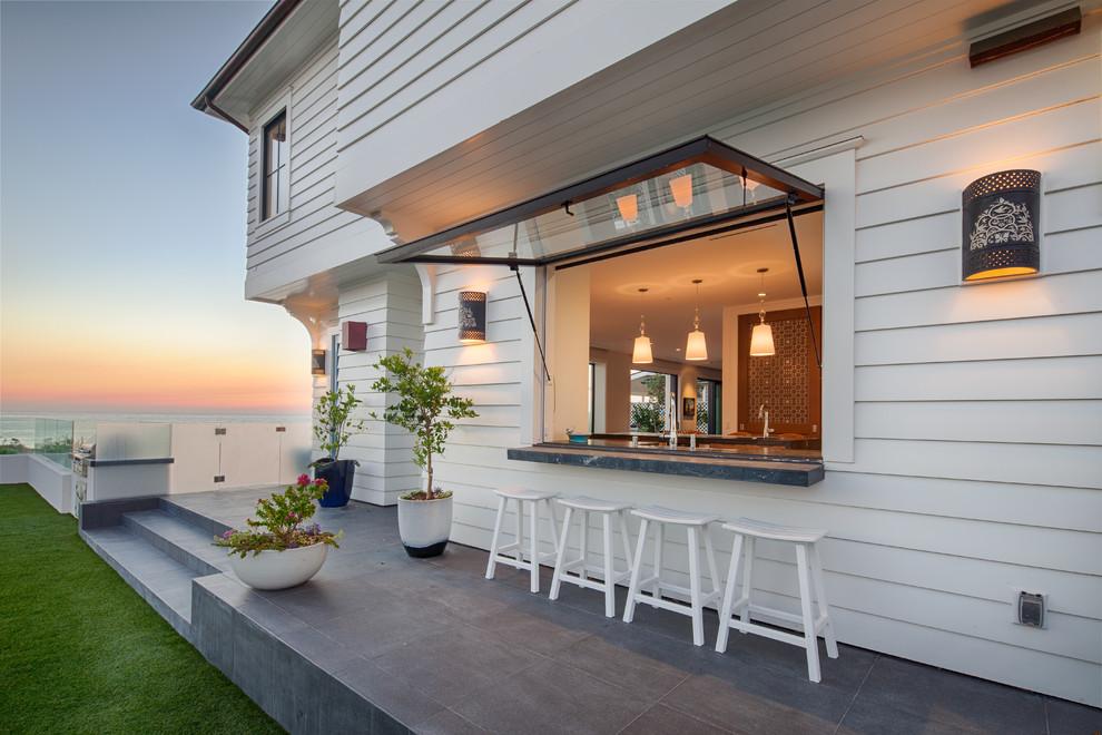 Patio - coastal backyard patio idea in San Diego