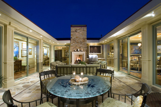 Traditional courtyard patio idea in Los Angeles with a fire pit
