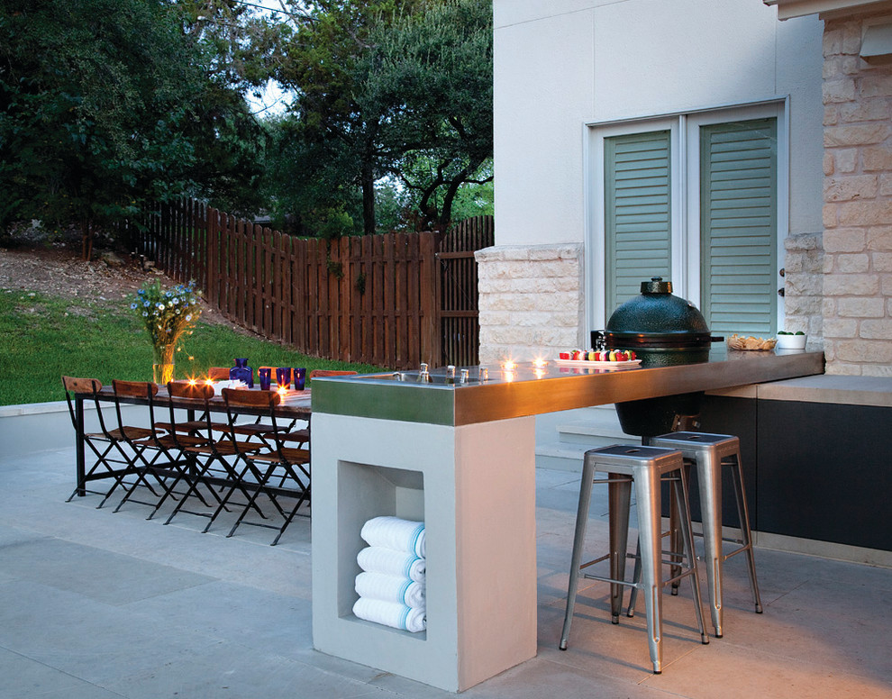 Mid-sized trendy backyard concrete paver patio kitchen photo in Austin with no cover