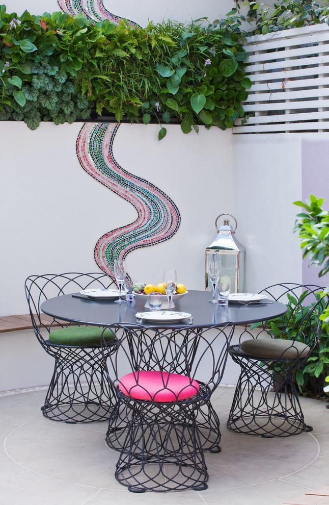 Patio - contemporary backyard patio idea in London with no cover