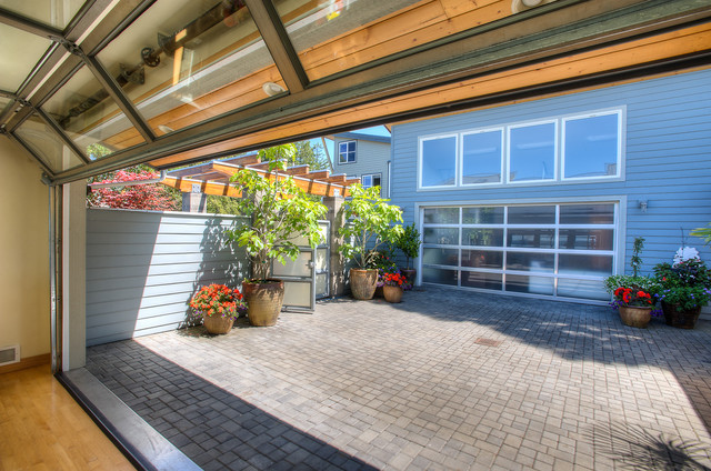 Courtyard with glass door up. beach-style-patio
