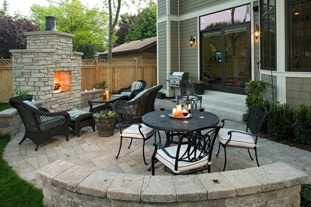Mid-sized elegant backyard brick patio photo in Chicago with a fire pit and no cover