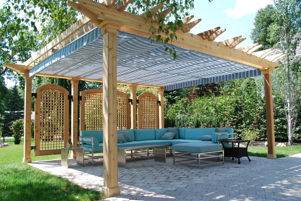 Patio - traditional backyard patio idea in Toronto with a pergola
