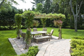 Outdoor dining room with open lattice cover.