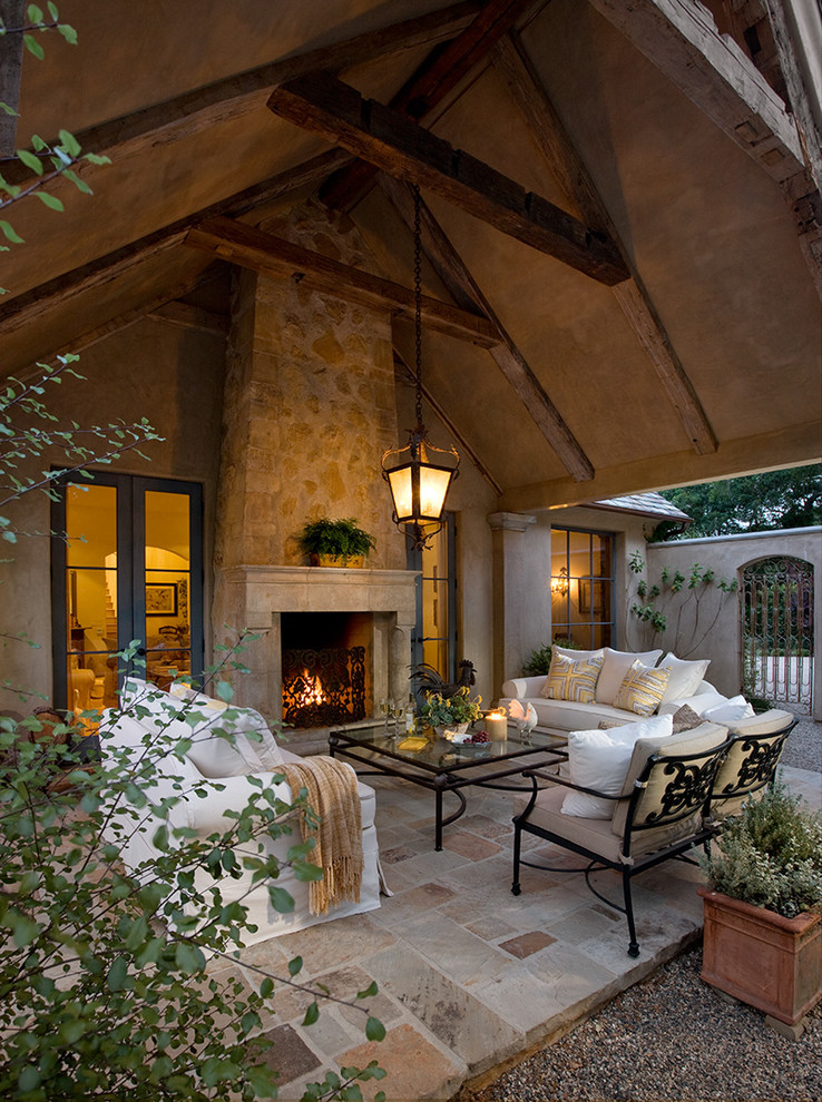 Inspiration for a mediterranean patio remodel in Santa Barbara with a fire pit