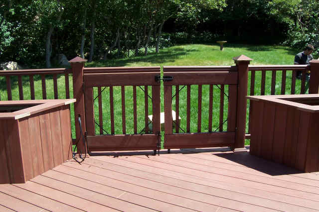 Pool Deck Gate Ideas trex deck pool gate Accents Saddle Wood Deck With Lighting And Gate Traditional Patio